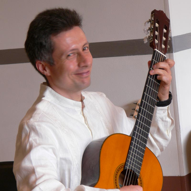 """Miguel Ángel Franco Martín is a guitarist and musician with a degree in music pedagogy from the Universidad Pedagógica Nacional. He studied recorder, modern harmony, arranging, orchestration, choir and orchestra conducting. Miguel is a teacher, director of vocal and instrumental groups. He studied classical guitar with Jaime Arias Obregón, Gentil Montaña and jazz guitar with Gabriel Rondón. He trained in the Suzuki method with Marilyn O'Boyle, Bill Kossler, MaryLou Roberts and Diana Chagalj. Since 2005, he has been teaching Suzuki guitar in his school """"Ad libitum Escuela de Guitarra"""".  He has also been a professor at the Universidad el Bosque, choir and orchestra director at the Fundación Batuta, Fundación Música en los Templos and Colegio Nuestra Señora de Fátima de la Policía Nacional."""